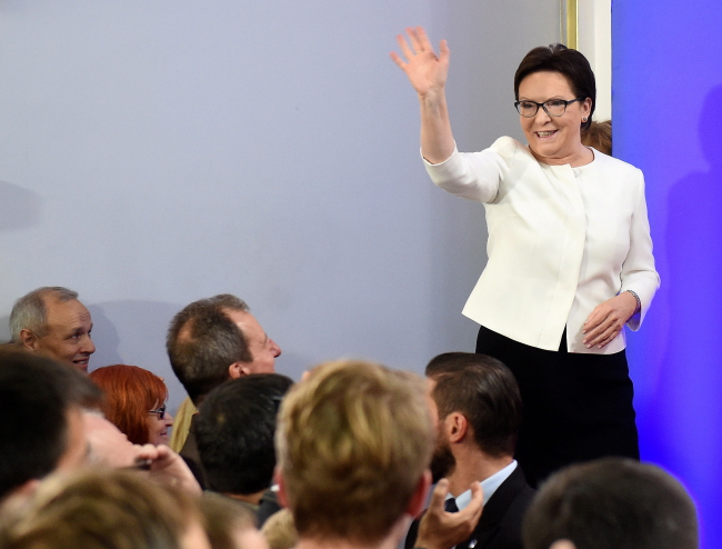 Ewa Kopacz waves to her supporters following the exit polls on Sunday. Photo: PAP/Radek Pietruszka