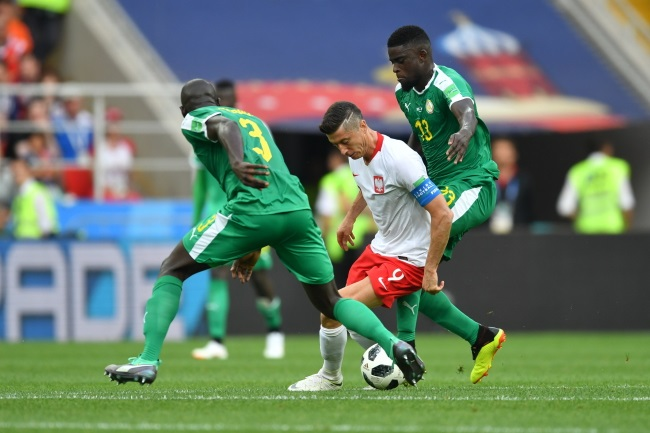 Poland captain Robert Lewandowski (centre) in action against Senegal's Kalidou Koulibaly (left) and Alfred N'Diaye (right) during Tuesday's match at Moscow's Spartak stadium. Photo: PAP/Bartłomiej Zborowski