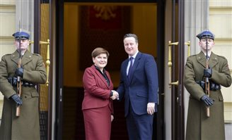 David Cameron lobbying in Warsaw