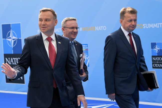Polish President Andrzej Duda (left), his chief of staff Krzysztof Szczerski (centre), and Defence Minister Mariusz Błaszczak (right) before the start of NATO's Brussels summit on Wednesday. PAP/Radek Pietruszka