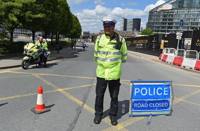 Police cordon off the Manchester Arena in Manchester, Britain, after a terror attack. Photo: EPA/ANDY RAIN