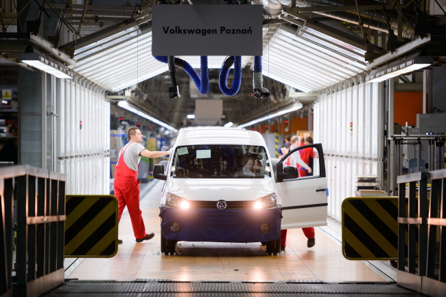 A new VW Caddy rolls off the line at the German automotive company's plant in Poznań, 04.02.2015 Photo: PAP/Jakub Kaczmarczyk