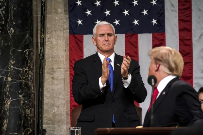 US Vice President Mike Pence applauds as President Donald Trump delivers the State of the Union address at the Capitol in Washington on Tuesday. Photo: EPA/Doug Mills