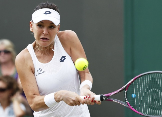Agnieszka Radwańska returns to Lucie Šafářová in their second-round match at Wimbledon. Photo: EPA/NIC BOTHMA