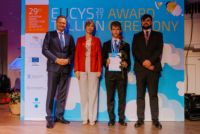 The European Commission's Robert-Jan Smits, Estonian President Kersti Kaljulaid, Kamil Humański, and president of the contest's jury Atilla Borics. Photo: EUCYS 2017.