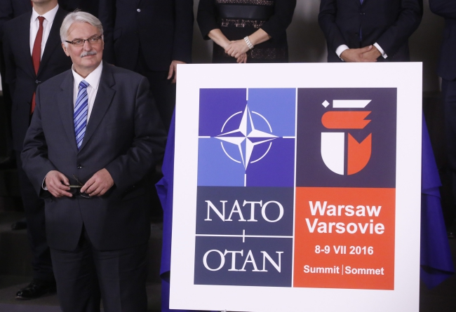 Foreign Minister Witold Waszczykowski presents the logo for the NATO Summit of Warsaw during a NATO Foreign Affairs Ministers Council at Alliance headquarters in Brussels, Belgium, 01 December 2015. EPA/OLIVIER HOSLET