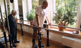 Paralysed man walks again after pioneering treatment in Poland