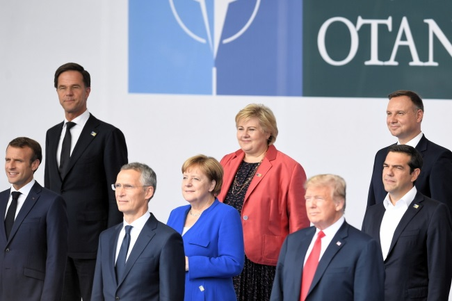 Polish President Andrzej Duda (right), US President Donald Trump (third from right) and German Chancellor Angela Merkel (fourth from left) pictured among heads of state and government gathered for the NATO summit in Brussels on Wednesday. Photo: PAP/Radek Pietruszka