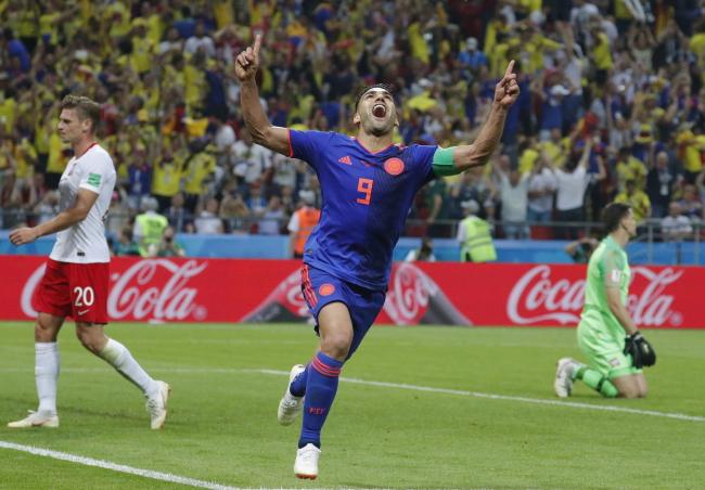 Colombia's Radamel Falcao scores against Poland. Photo: EPA/ROBERT GHEMENT