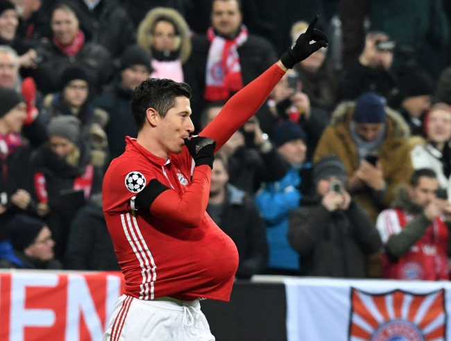 Robert Lewandowski celebrates a goal dedicated to his unborn baby. Photo: PAP/EPA/PETER KNEFFEL.