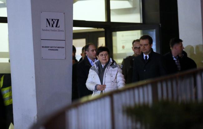 PM Beata Szydło (C) leaving the hospital on Friday. Photo: PAP/Jakub Kamiński