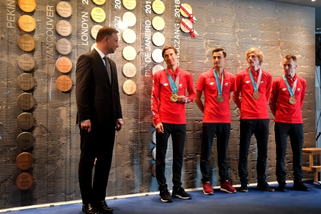 President Andrzej Duda (left) and ski jumpers Kamil Stoch, Maciej Kot, Dawid Kubacki, and Stefan Hula during the Olympic Gala event in Warsaw on Saturday. Photo: Bartłomiej Zborowski, PAP