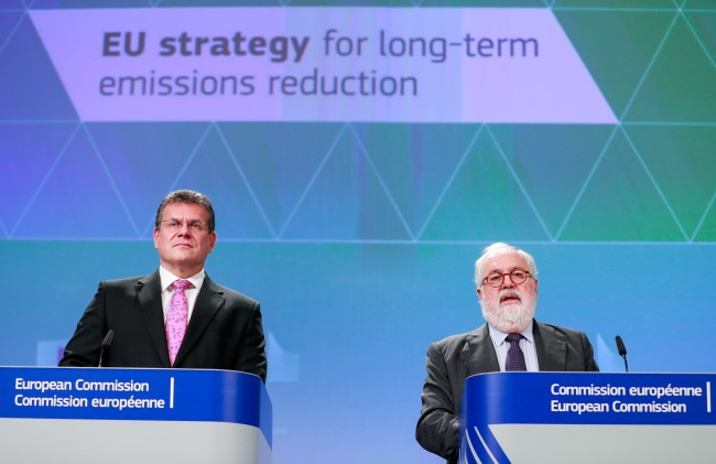 """European Commission Vice-President for Energy Union Maroš Šefčovič (left) and Commissioner for Climate Action and Energy Miguel Arias Cañete give a press conference on the long-term strategic vision for """"A Clean Planet for All"""" in Brussels, Belgium, on Wednesday. Photo: EPA/STEPHANIE LECOCQ"""