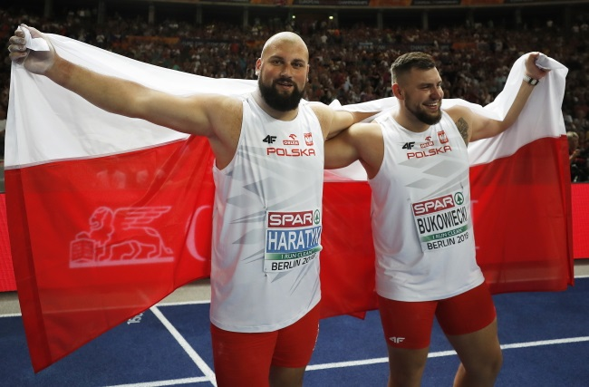 Poland's Michał Haratyk and Konrad Bukowiecki celebrate after winning gold and silver respectively in the men's shot put event at the 2018 European Athletics Championships in Berlin, Germany, on Tuesday. Photo: EPA/CHRISTIAN BRUNA