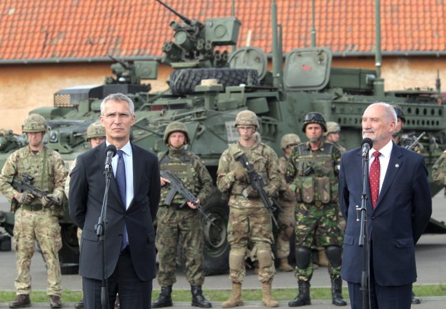 Jens Stoltenberg (L), defence minister Antoni Macierewicz (R) at press conference.