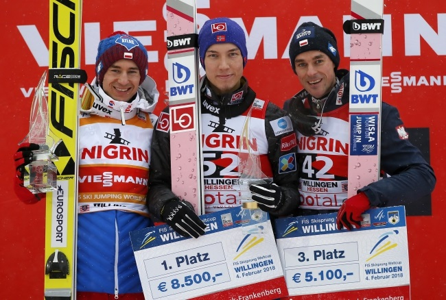 Second-placed Kamil Stoch of Poland, winner Johann Andre Forfang of Norway, and third-placed Piotr Żyła of Poland pose on the podium during the awards ceremony of the FIS Ski Jumping World Cup event in Willingen, Germany, on Sunday. Photo: EPA/RONALD WITTEK