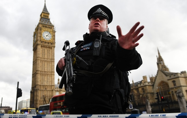 Armed police push people back following major incidents outside the Houses of Parliament in central London