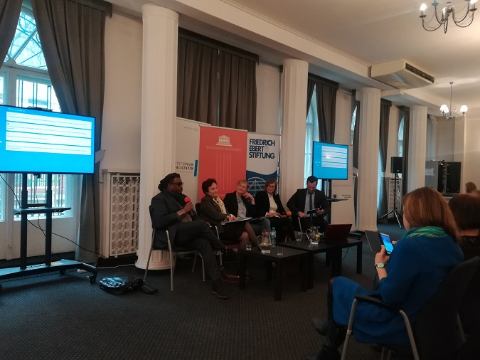 Larry Olomofe (left) speaking at a conference on hate speech organized by the Institute of Public Affairs and the Friedrich Ebert Foundation in Warsaw. Photo: Radio Poland