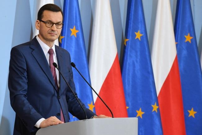 Polish Prime Minister Mateusz Morawiecki briefs reporters after a Cabinet meeting on Tuesday. Photo: PAP/Radek Pietruszka