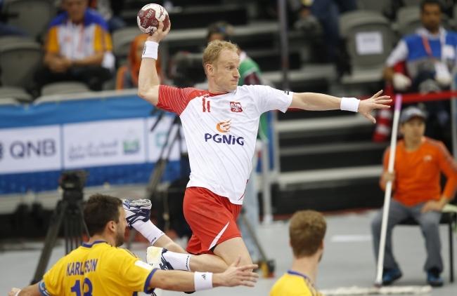 Adam Wisniewski of Poland in action during the Qatar 2015 24th Men's Handball World Championship Round of 16 match between Poland and Sweden at the Ali Bin Hamad Al-Attiya Arena at Al-Saad Club in Doha, Qatar on 26 January 2015. Photo: EPA/Ali Haider