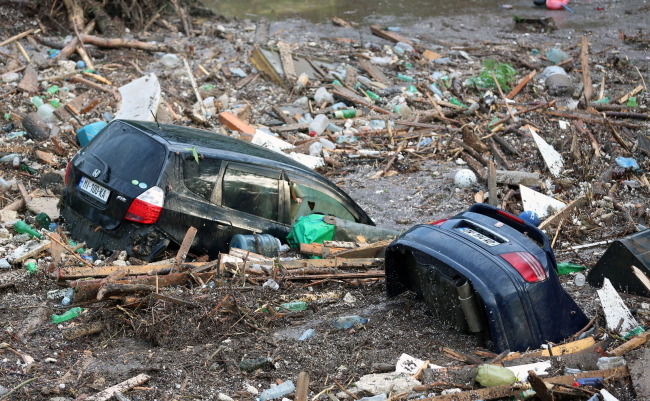 A handout picture provided by the Georgian Prime Minister's press office shows cars submerged in floodwaters in Tbilisi, Georgia, 14 June 2015. Photo: . EPA/BESO GULASHVILI