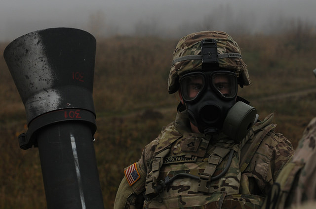 Dennis Drazkowski prepares to fire mortars during a nuclear, biological and chemical exercise in support of Operation Atlantic Resolve. Photo: cc/U.S. Army/Spc. Audrey Ann Hayes, 214th Mobile Public Affairs Detachment
