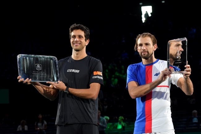 Kubot (right) and Melo celebrate with the trophy after winning the doubles final match at the Rolex Paris Masters tennis tournament in Paris, France, on Sunday. Photo: EPA/CHRISTOPHE PETIT TESSON