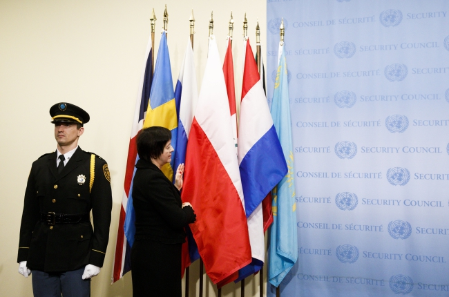Joanna Wronecka places the Polish flag during a flag ceremony marking the start of a new two-year term for non-permanent members of the UN Security Council. Photo: EPA/JUSTIN LANE.