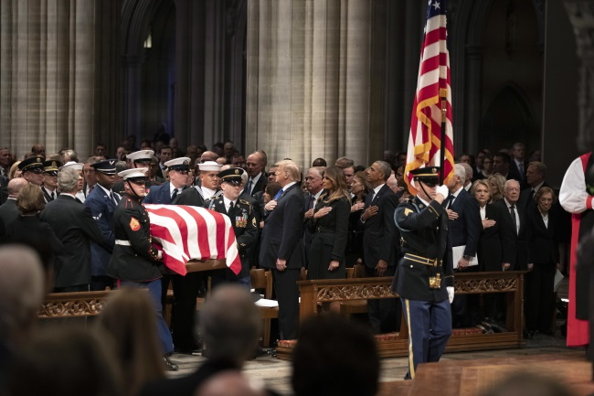 The flag-draped casket of former US President George H.W. Bush is carried by a military honor guard during a state funeral at the National Cathedral in Washington on Wednesday. Photo: EPA/ALEX BRANDON