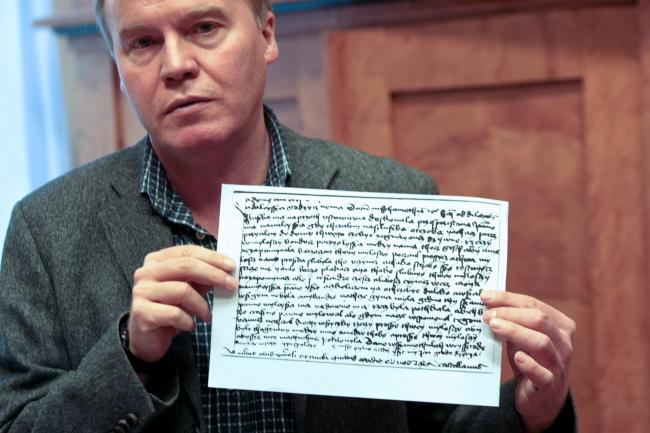 Andrzej Kirmiel, director of the regional museum in Międzyrzecz, shows a facsimile of the first love letter written in Polish. Photo: PAP/Lech Muszyński